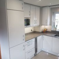 white gloss kitchens, gloss kitchen Newtownards, modern kitchens Bangor, Granite and silestone worktops Newtownards, Red Leaf kitchens & Interiors
